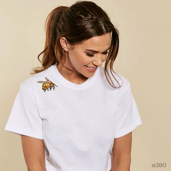 The bee is on the shoulder